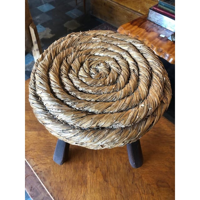 Lovely wood and natural fiber seat ottoman by Audoux Minet.