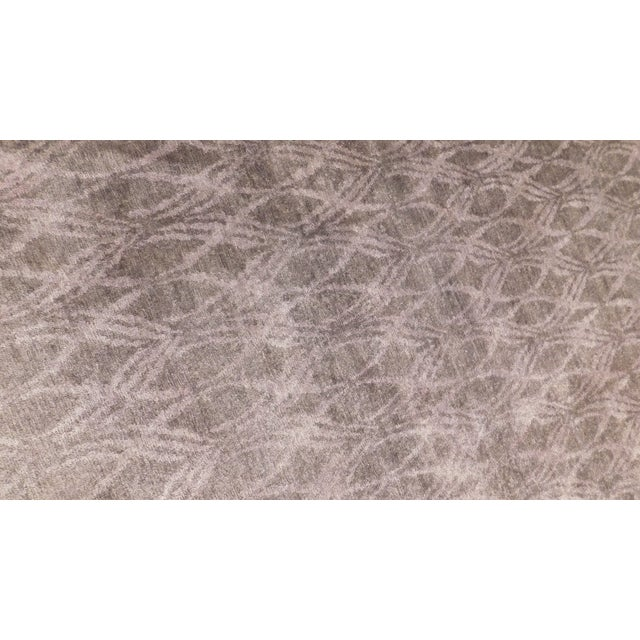 Modern hand-knotted luxury rug made in India. Material: Bamboo Silk Primary Color: Purple Secondary Color: Light purple