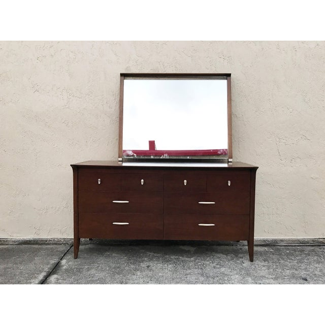 Mid-century modern solid walnut dresser and matching removable sculpted floating form mirror. Drexel designed by John Van...