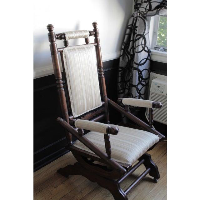 Beautiful antique Eastlake chair. Solid Walnut Turned Construction, Platform Spring Rocking Base.