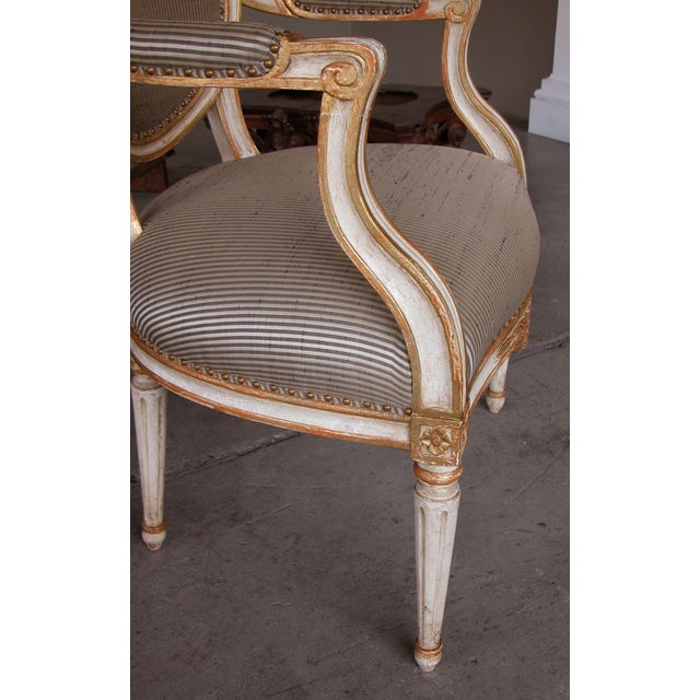 A Pair of Gustavian Style Ivory Painted & Parcel Gilt Armchairs For Sale - Image 4 of 7