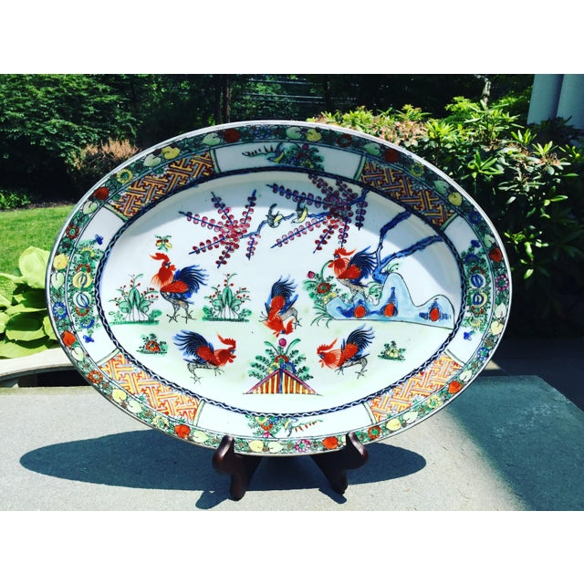 Vibrantly colored rooster platter from China, circa early to mid 20th Century.signed. Heavy and substantial ceramic material.