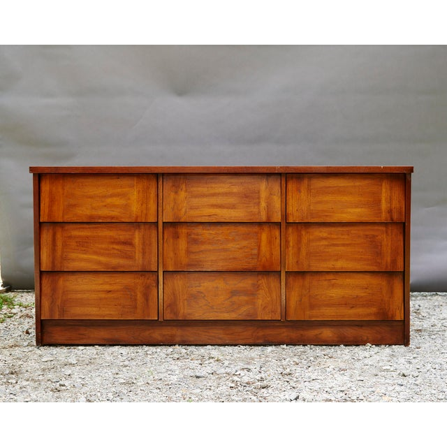 Modern nine drawer dresser, sideboard, buffet. Wedge style drawer fronts with handle notch on bottom edge of the drawer....