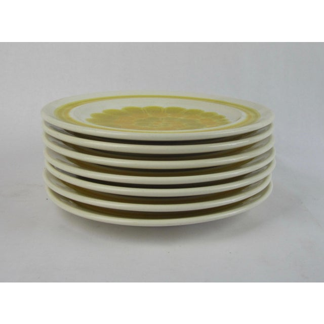 "Set of seven salad or hors d'ouvres plates in ""Sundance"" pattern from the 70's. Colors will brighten up any table."