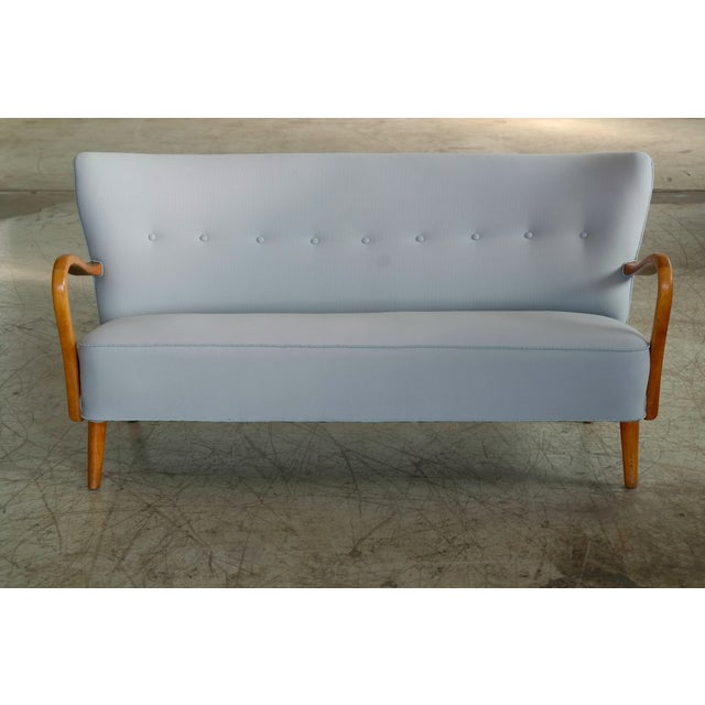 Fantastic 1940s Alfred Christensen designed sofa in his characteristic style of open armrests carved from solid elm wood...