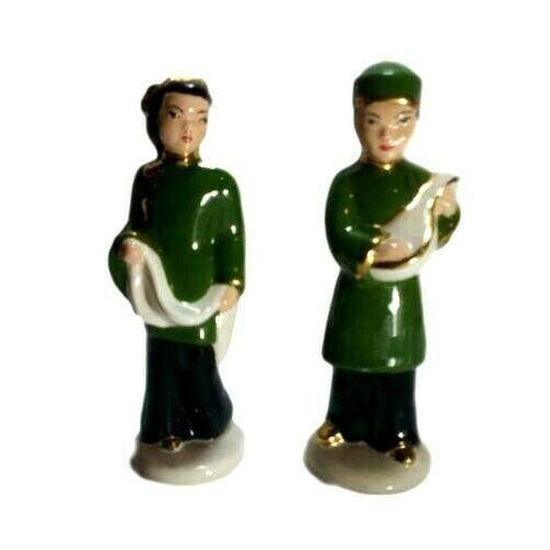 Vintage porcelain Asian couple figurines. Shipped with USPS Priority Mail. Couple is wearing green and black attire with...