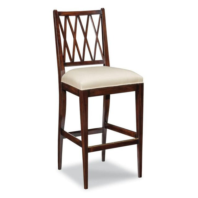 Gracefully tapering legs elevate an upholstered seat below a lattice work back. Material: Hardwood solids.