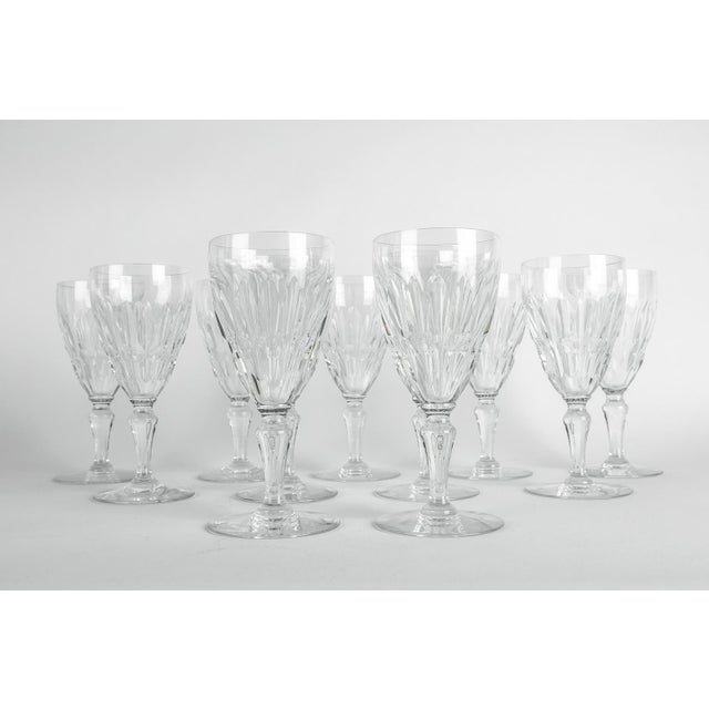 This is a Mid-20th century Baccarat crystal wine or water glassware set of 12 pieces. Each glass is in excellent...