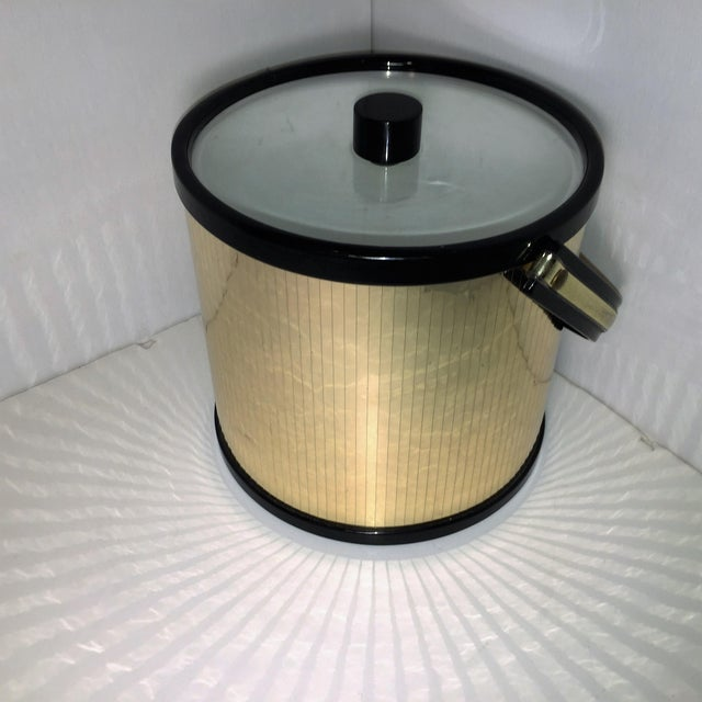 Glamorous gold Ice bucket. Somewhere between Mid-century modern and reviving disco, this steals the show. Its beautiful...