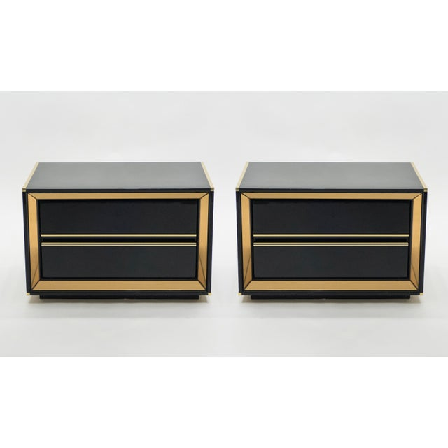 This pair of Italian Hollywood Regency black lacquered night stands or end tables would be stunning in any room. The shiny...