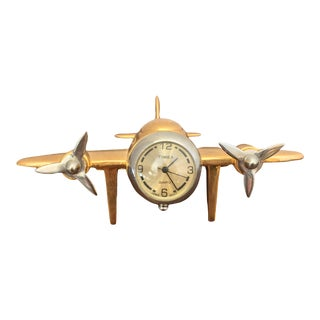 1970s Vintage Gold Tone Timex Airplane Clock For Sale