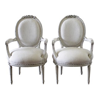 Early 20th Century Carved and Painted Louis XVI Style French Open Arm Chairs- A Pair For Sale