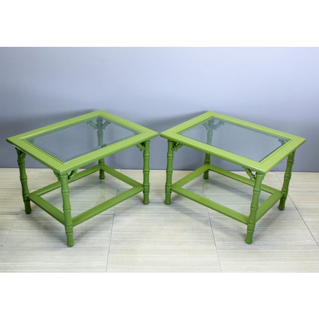 Vintage pair of bamboo style two-tiered side tables with glass tops This beautiful tables have been nicely painted in...