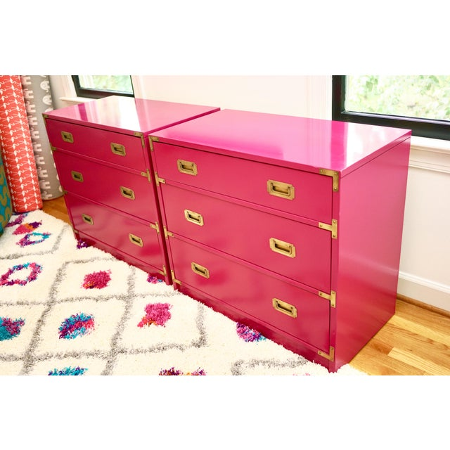 Forward fuscia lacquered vintage campaign dressers- a pair! Can be pushed together, used as nightstands, or in totally...