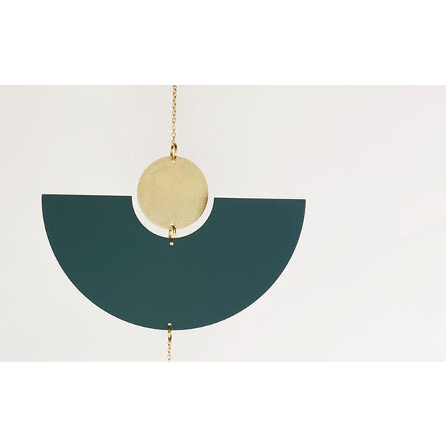 The graphic combination of the brass and green tones create a fun color play to the already playfulness to the geometric...
