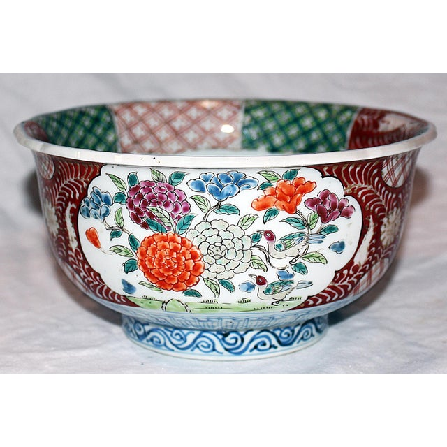 Antique Japanese Imari faience bowl in classic colors with 24k gold decoration. There is some finish wear to rim.