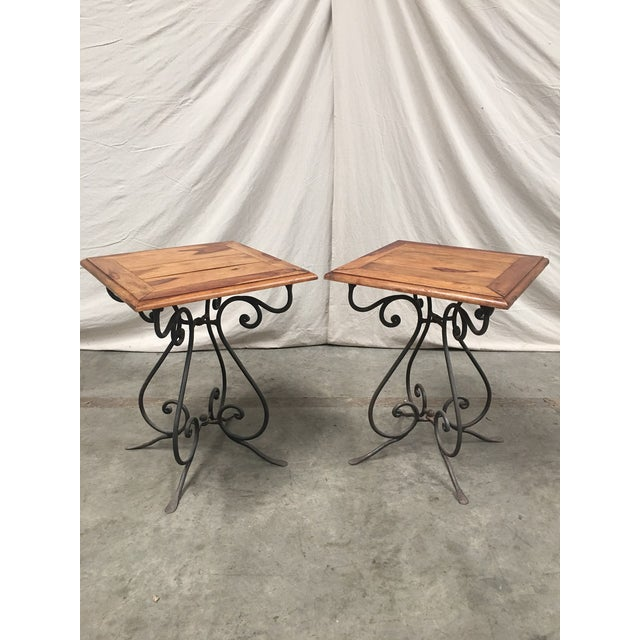Fabulous pair of French bistro tables, with square tops, and iron bases. This lovely pair of tables have solid walnut wood...