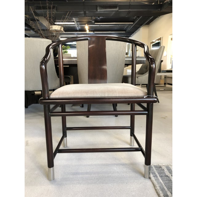 A set of four Ming chairs from Brueton furniture. 1990s Vintage. New item from showroom floor. Some minor scuffs visible...