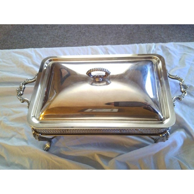 Made in the U.S.A., this 3-piece chafing set from The Sheffield Silver Company is an elegant edition to any buffet....