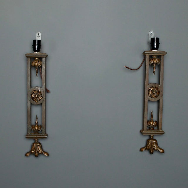 This Belgian pair of iron wall sconces are just under two feet tall. The sconce bases are made from 19th century antique...