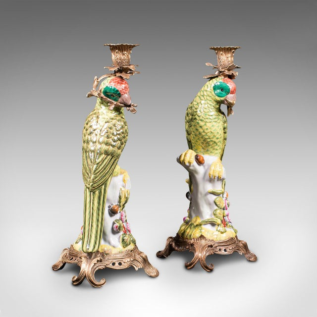 This is a fine pair of vintage decorative candlesticks. An Oriental, ceramic parakeet figure as a candelabra, dating to...