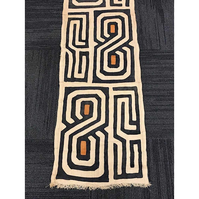 This handwoven Kuba cloth was created in the Democratic Republic of The Congo (formerly Zaire) and dates to the last...