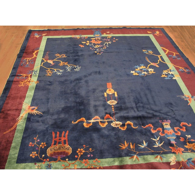 Antique Chinese Art-Deco rug with navy background bordered by bright red