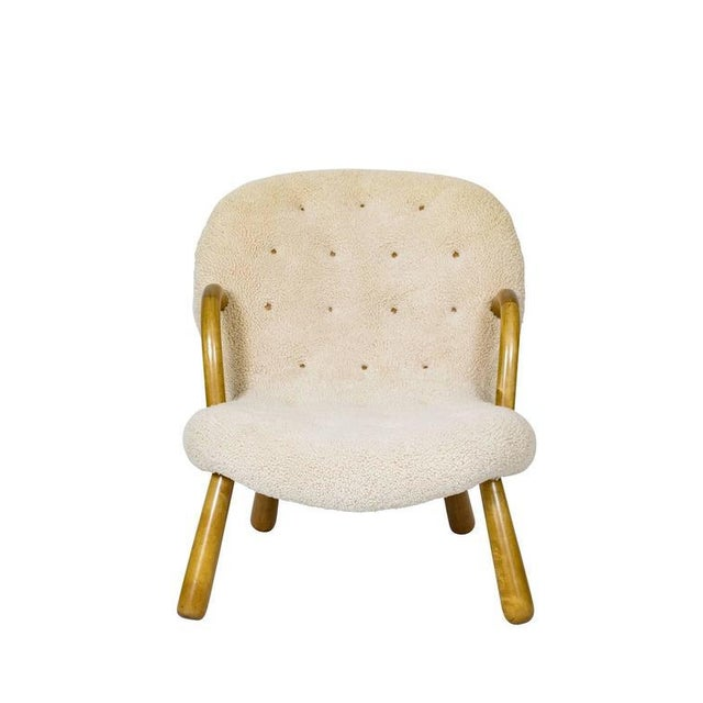 "Philip Arctander ""Clam"" chair covered in sheepskin. Store formerly known as ARTFUL DODGER INC"