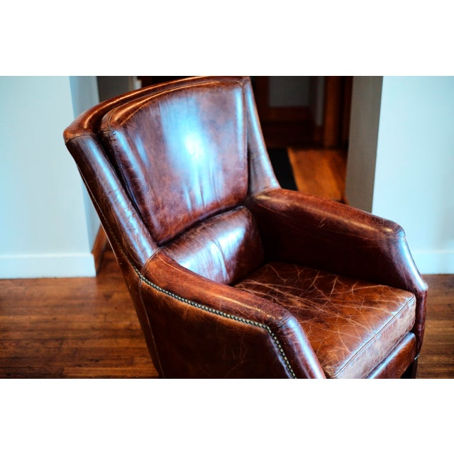 This is a vintage leather club chair that has hardly been used. The leather of course has vintage stressed look in...
