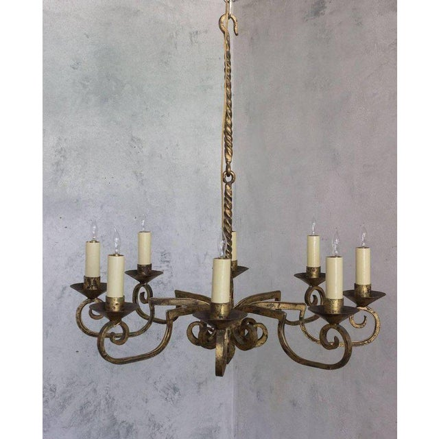 Spanish gilt wrought iron chandelier with eight arms in distressed gilt finish. Price include UL wiring and Canopy , ready...
