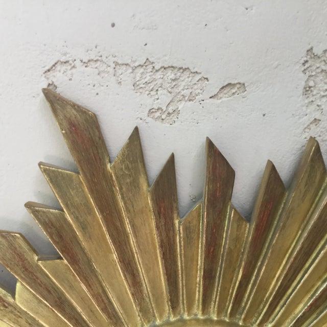 French mid-century gilded wood sunburst convex mirror circa 1950.