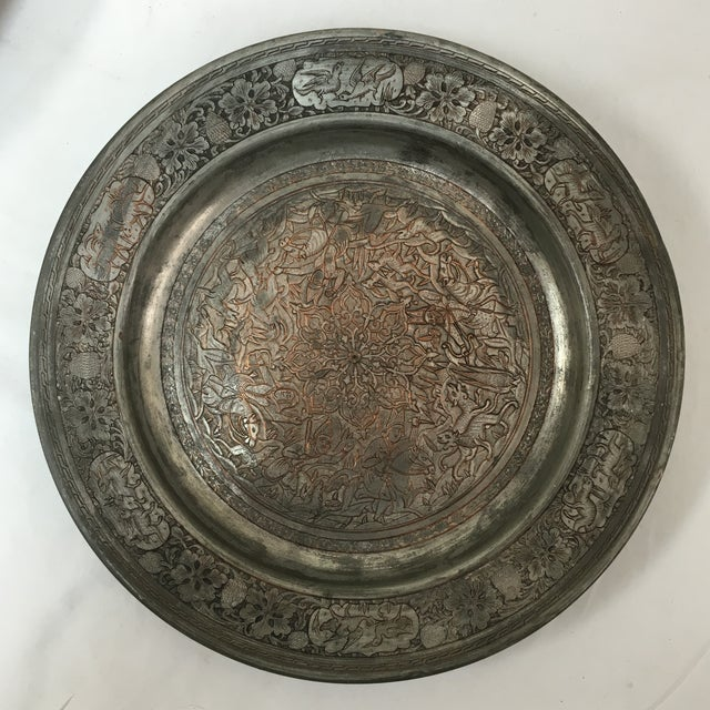 """9""""D Antique etched Persian tinned copper plate depicting a hunt scene around a center medallions with different groupings..."""