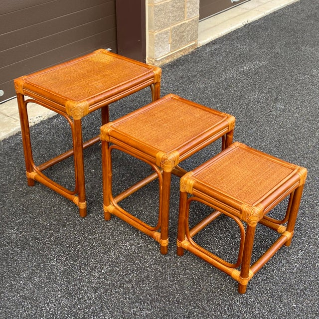 """A nice nest of rattan tables with woven tops & leather wrapped bamboo joints! Largest 22.25""""x16.25""""x23""""h Medium..."""