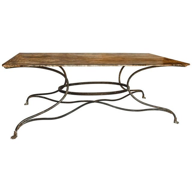 This French garden table with unusual rectangular top from the early 20th century is from Arras, a city located in...