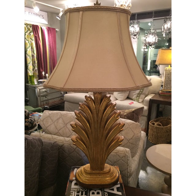 This beautiful wood carved leaf lamp has stunning gold leaf finishing. Lamp sits atop a wooden base and comes with a...