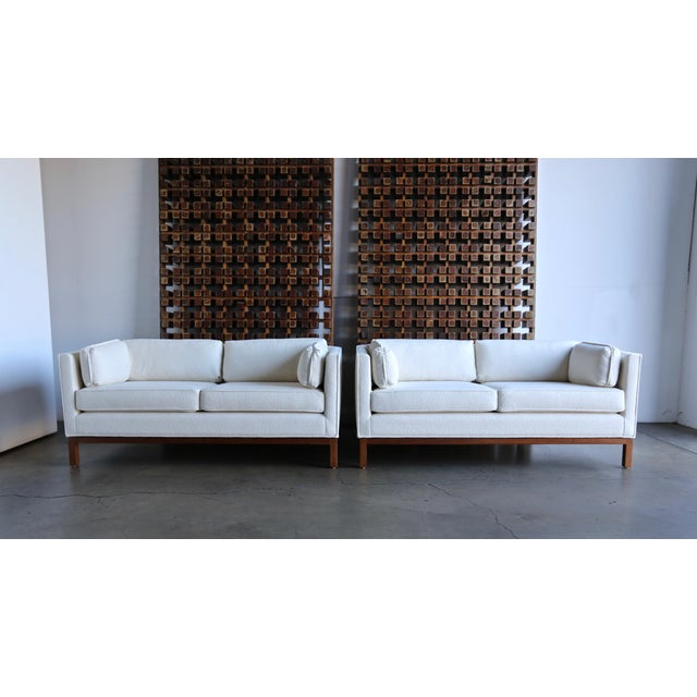 Roger Sprunger pair of curved back settees for Dunbar, circa 1960. This pair has been professionally restored.