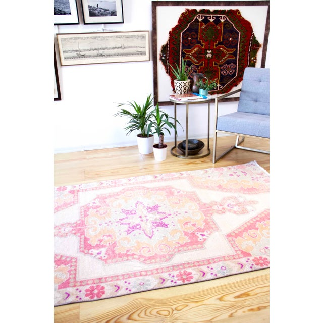 This is a 50-year-old handmade vintage Western Anatolian rug. Due to the region, it was made in it is called a 'Oushak'...