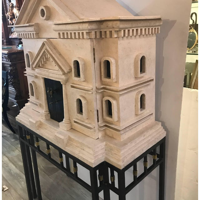 Incredible sand stone wood and metal bar on stand in the shape of a Greek Revival mansion. The sandstone and wood bar with...