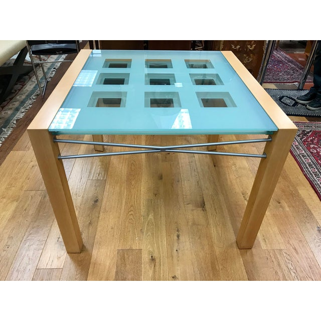 Ligne Roset solid beech extendable table has frosted glass panels and decorative inset clear-glass squares. It seats 6...