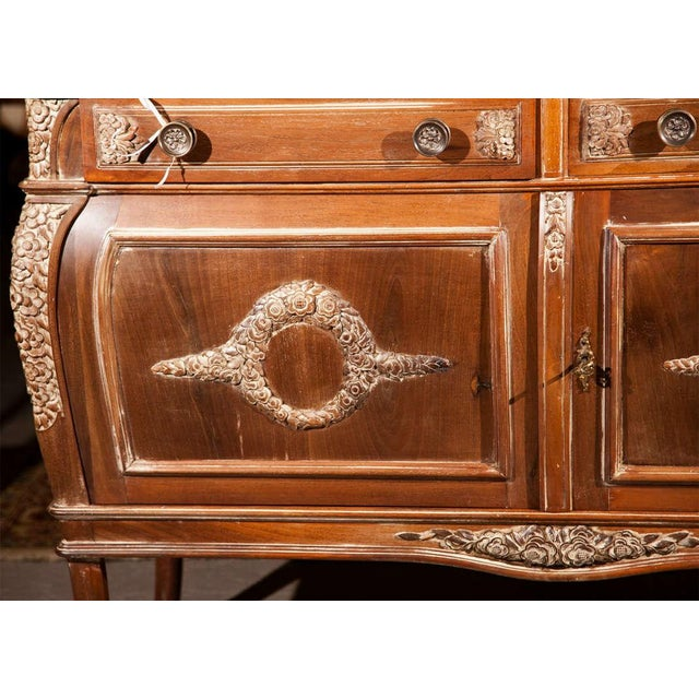 A spectacular French Empire style sideboard, the dark green marble set in a molded top, over a conforming case in a...