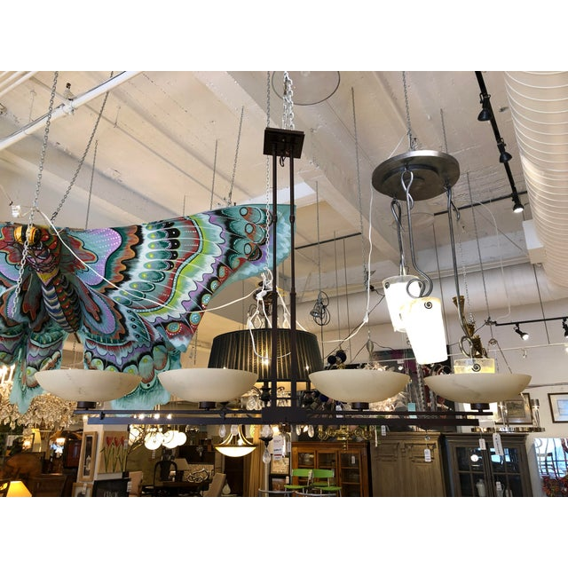 Design Plus Gallery Presents a four light trestle pendant chandelier by Hubbardton Forge. A large wrought iron beauty from...