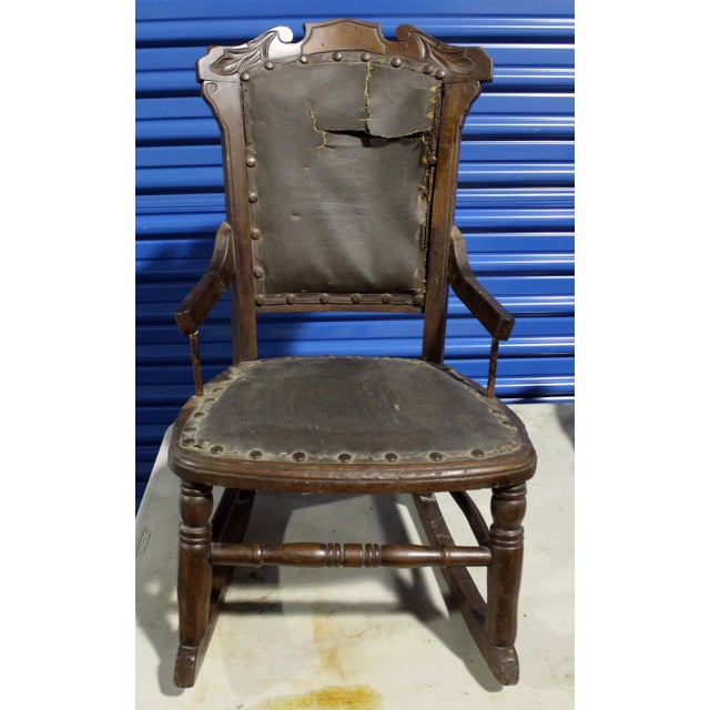 American 19th-century child's rocker. Leather over horsehair and canon. Hardwood construction.