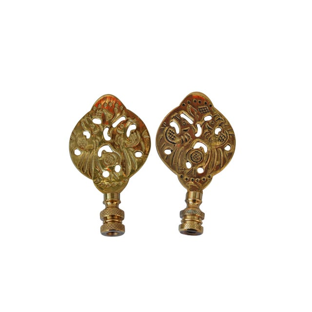 A pair of Chinoiserie style solid brass finials. Fits a standard size lamp harp. Measurements per finial.