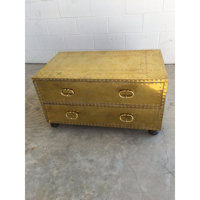 Beautiful brass coffee table by Sarreid LTD. Made of solid brass clad over solid wood with copper nail detail. Heavy side...
