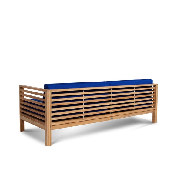 The Summer Teak Outdoor 3 Person Sofa with Sunbrella Cushion is designed with space and practicality in mind. It has a...