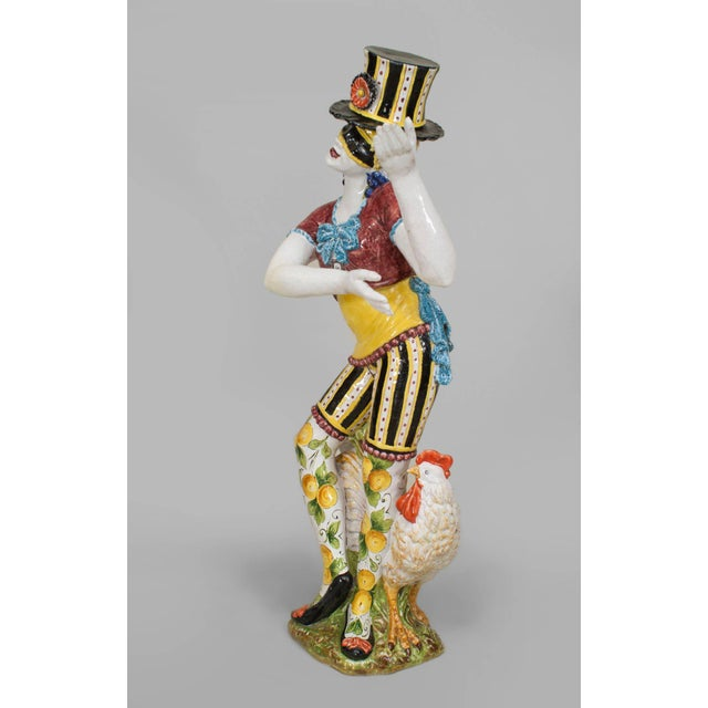 Pair of turn of the century Italian Majolica porcelain male and female harlequin figures each wearing a top hat, striped...