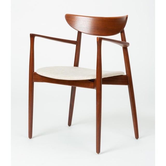 Designed circa 1960 by Harry Østergaard, this set of dining chairs includes two arm chairs and two side chairs....