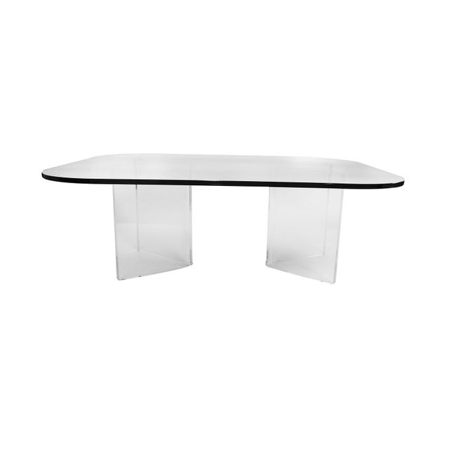 An elegant, stylish mid century rectangular rounded corners glass top, with Lucite base coffee table. Features a unique...