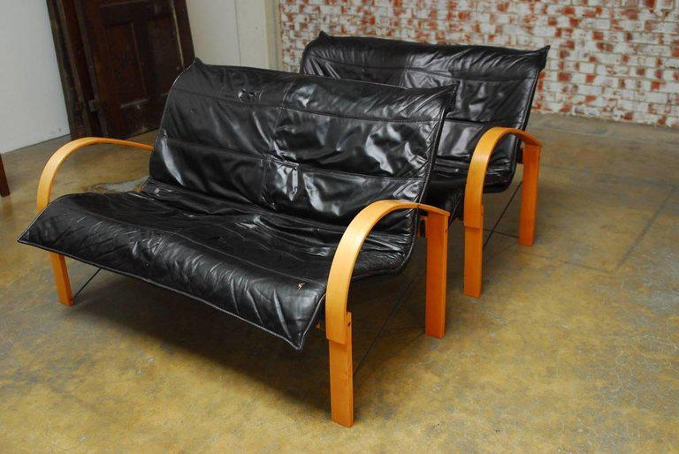 Ergonomic Pair Of Mid Century Scandinavian Black Leather Sofas Or Settees  Featuring A Bentwood Frame