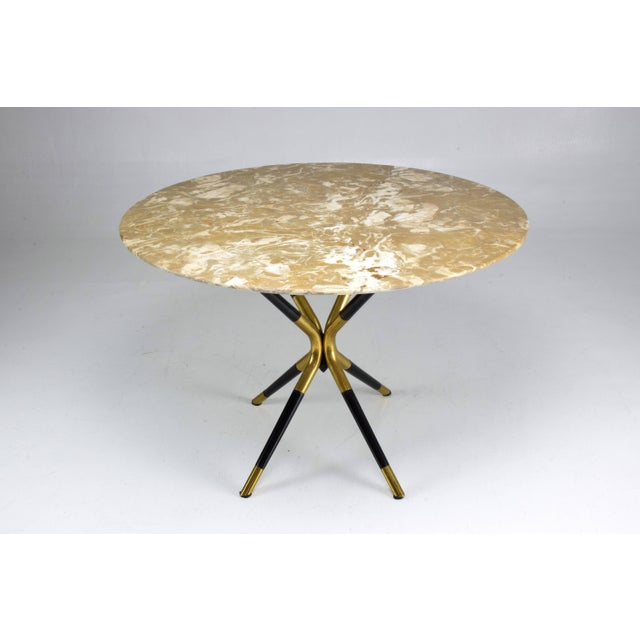 A 20th century vintage circular coffee or side table designed by Italian master Cesare Lacca circa 1950s and composed of a...